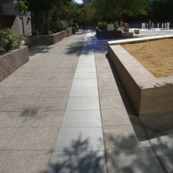 Butterfly Black Basalt Square Pavers in Ribbon use a Flamed and Brushed Finish - CityScape - HDG Building Materials