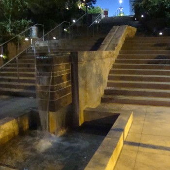 Charles Korrick Fountain Flowing at Night - Charles Korrick Fountain - HDG Building Materials