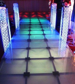 Buzon Trasclucent Pedestals on Lighted Glass Stage - HDG Building Materials