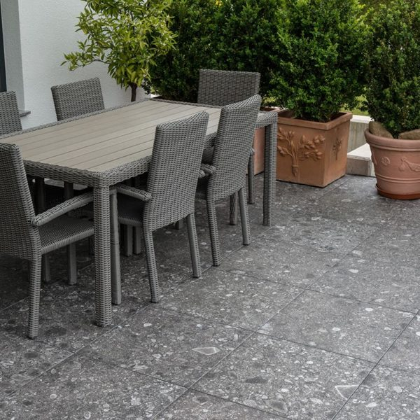 Outdoor Dining Area with HDG PIETRA Sierra Smoke Porcelain Tile - HDG Building Material