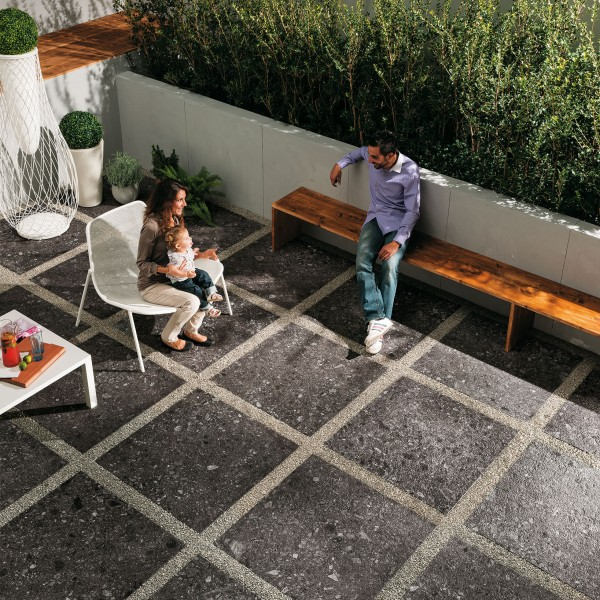 Lounging Area with HDG PIETRA Sierra Smoke Porcelain Tile - HDG Building Material