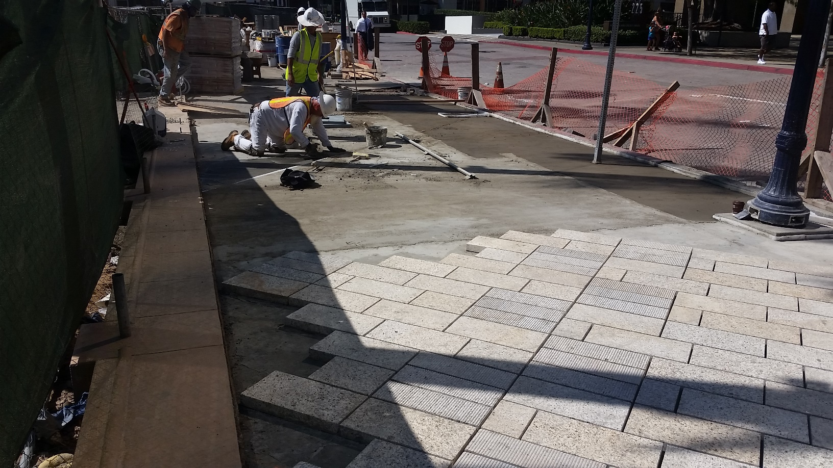 Installation of Tiger Yellow Granite with Round Score Finish Natural Stone Pavers at Horton Plaza San Diego - HDG Building Materials