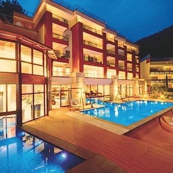 Resysta TruGrain Decking Quellenhof Pool at Night - HDG Building Material