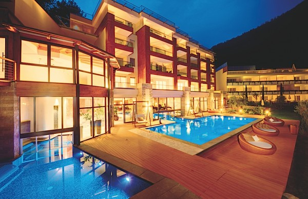 Resysta TruGrain Decking Quellenhof Pool at Night - HDG Building Material