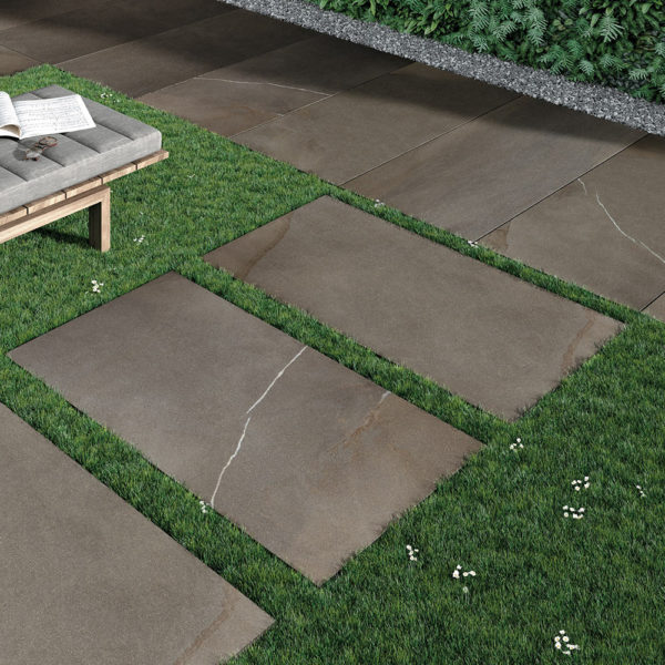 HDG Pietra Pavero Brown Porcelain Pavers EP06 Placed on Grass - HDG Building Materials