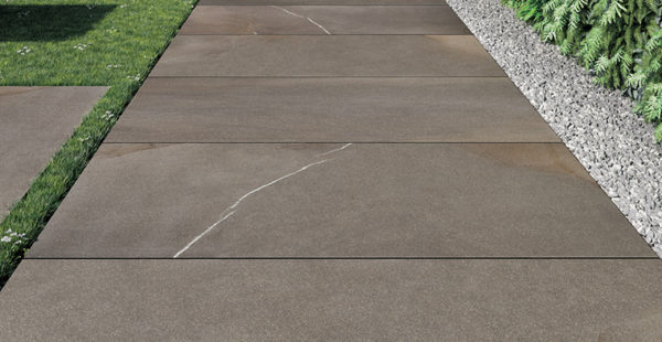 HDG Pietra Pavero Brown Porcelain Pavers EP06 on Grass and Gravel - HDG Building Materials