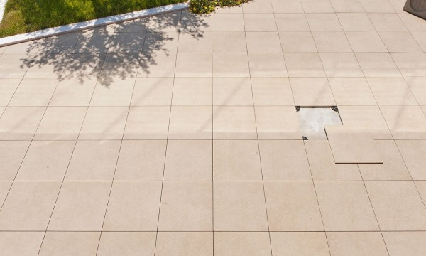 HDG Berona Cream Porcelain Pavers Installation Over Buzon Pedestals in Raised Terrace Application