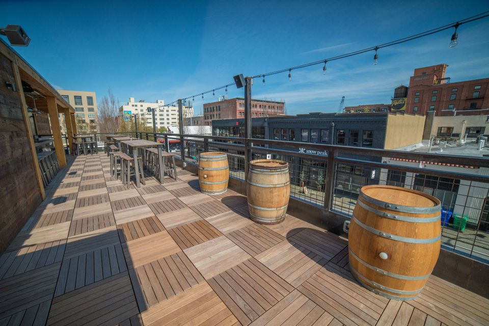 ipe wood deck tiles over Buzon pedestals on rooftop deck - Expert dealer HDG Building Materials