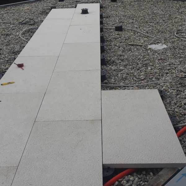 Buzon Pedestals and Porcelain Pavers in Commercial Rooftop Decking Application - HDG Building Materials