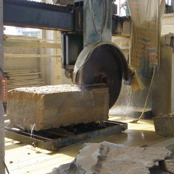 image of Giant Block of Stone Being Cut In HDG Building Materials Partner Factory in China