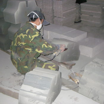 image of Skilled Craftsman Shaping and Finishing Stone by Hand Machine at HDG Building Materials Partner Factory in China