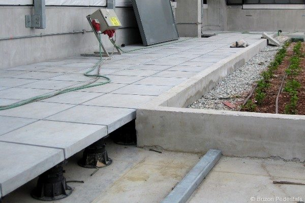 Buzon Pedestals with Hidden Services Below Stone Pavers - HDG Building Materials