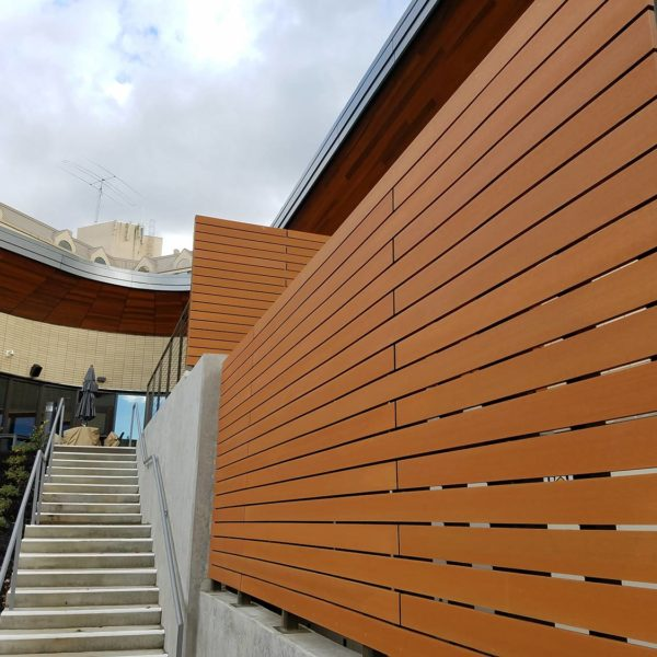 Resysta Rust Stained Horizontal Slat Fence Application - HDG Building Materials
