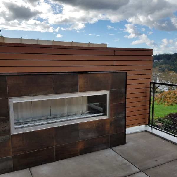 Reysta Horizontal Cladding On Rooftop Dining Area Fireplace - HDG Building Materials