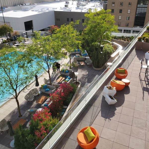 Terrace Overlooking Pool Deck Uses Buzon Pedestals and Concrete Pavers - HDG Building Materials