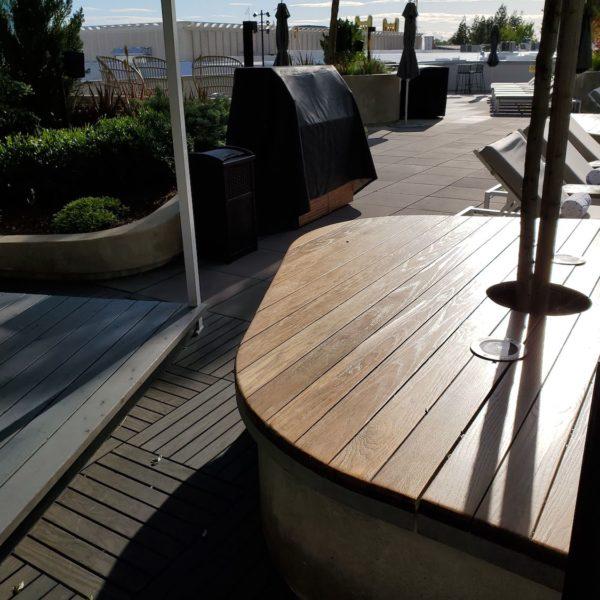 Wood Decking Tiles Transition to Concrete Pavers Easily with Buzon Pedestals - HDG Building Materials