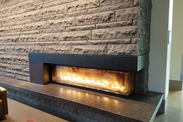 Honed Finish on HDG Perlino Grey Limestone Reduces Glare from Fireplace and Lighting - HDG Building Materials