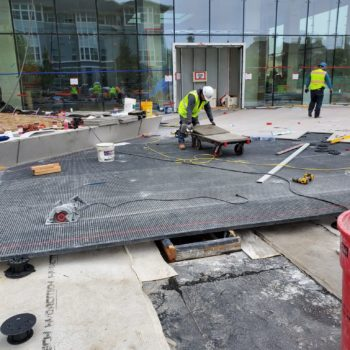 HDG Grating Panels On Slope with Porcelain Pavers and Buzon Pedestals - HDG Building Materials