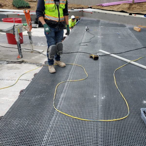 Creating a Uniform Platform for Porcelain Pavers Over an Uneven Substrate