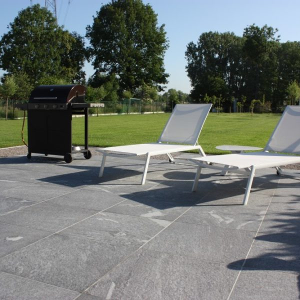 Outdoor Terrace in Sunlight Shows Finish of HDG Orgami Grey Porcelain Pavers - HDG Building Materials