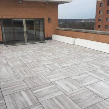Acacia 60x60cm Porcelain Deck Tiles Installed over Raised Pedestals