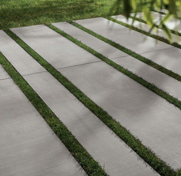 CC-Moda Grey 2cm Outdoor Porcelain Pavers on Grass - HDG Building Materials