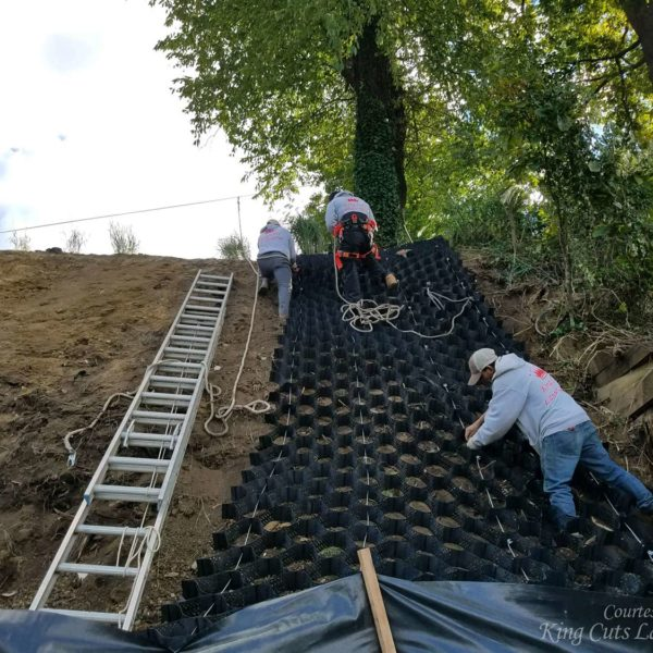 Team Installing SlopeGrid for Retaining Wall on Steep Slope