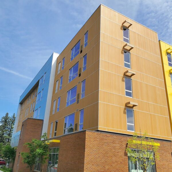 Resysta Cladding Vertical Installation on ROCK Apartments - HDG Building Materials