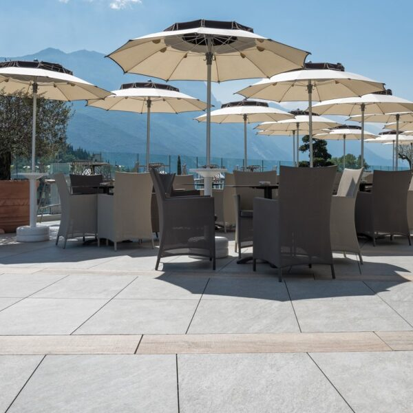 Sierra Grey Porcelain Pavers in Outdoor Dining Application Hospitality Design - HDG Building Materials