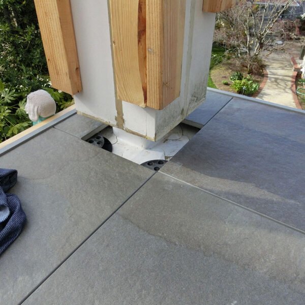 Column Interface to Porcelain Pavers Over Buzon Pedestals on Balcony - HDG Building Materials