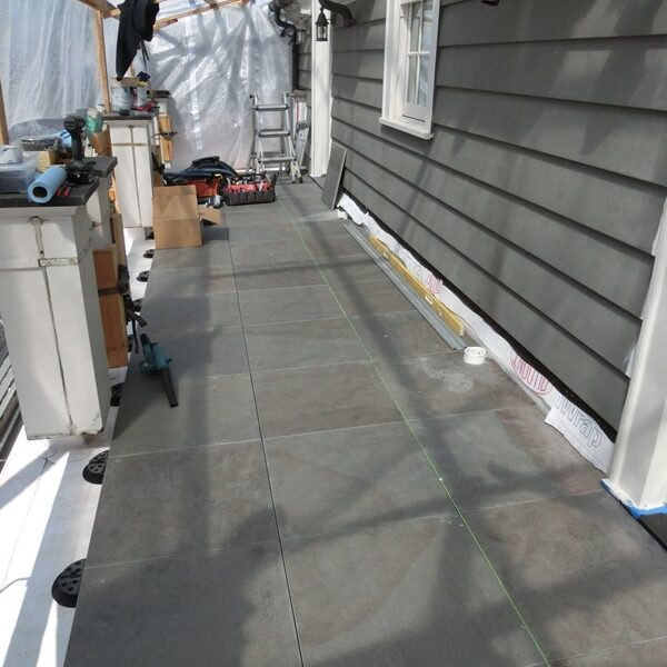 HDG Pietra Kaia Blue Porcelain Pavers on Remodeled Balcony - HDG Building Materials