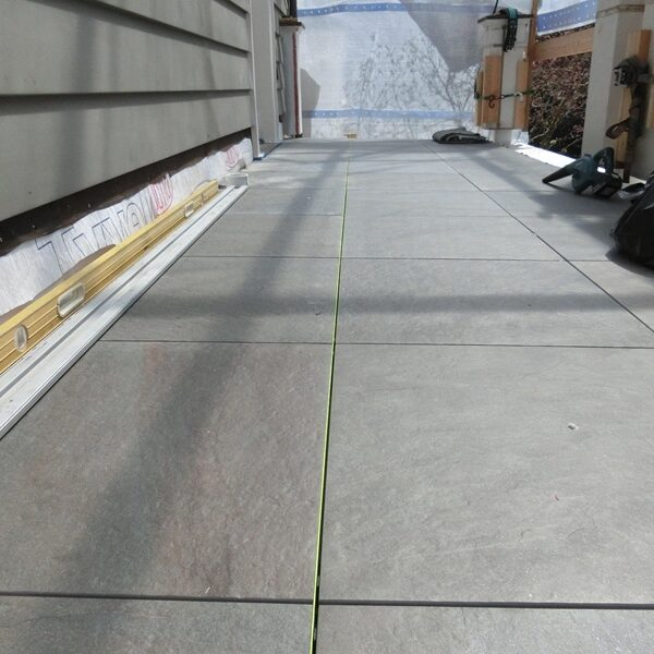 Perfectly Straight Porcelain Pavers with Even Gaps Due to Buzon Spacer Tabs - HDG Building Materials