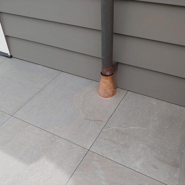 Porcelain Pavers Cut Detail Around Downspout - HDG Building Materials