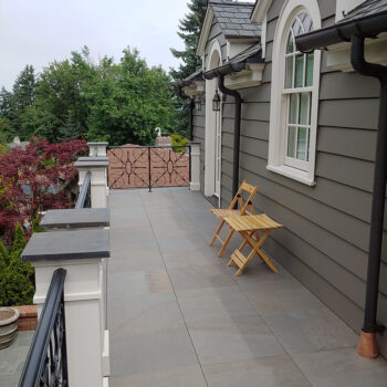 Stone Look Balcony with Porcelain Pavers Over Buzon Pedestals - HDG Building Materials