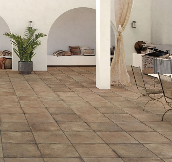 Outdoor Courtyard Dining Area with HDG Copper Porcelain Pavers