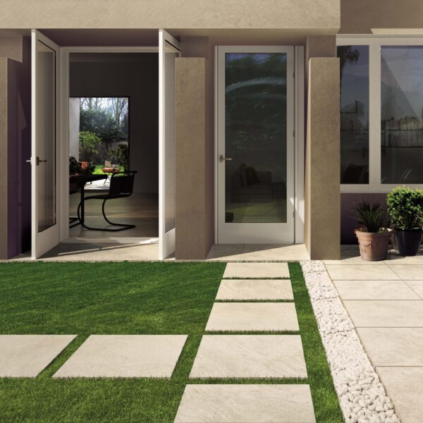 Grass Laid Outdoor Patio with Bianca Porcelain Pavers