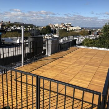 Buzon Pedestal Supported Black Locust Deck Tiles on Rooftop Deck