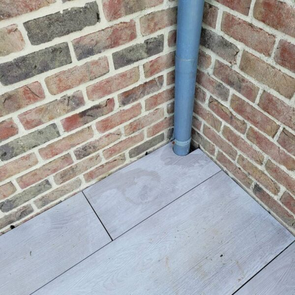 Installed Porcelain Paver Corner Piece to Perfectly Fit Pipe Obstruction
