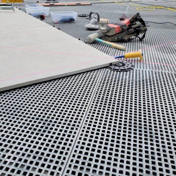 Porcelain Pavers Set on Buzon Pedestals Over HDG Grating Panels